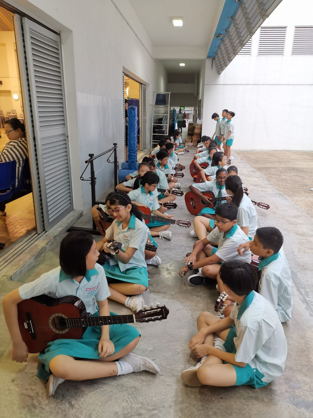 3. P6 students etting ready for their guitar performance.JPG