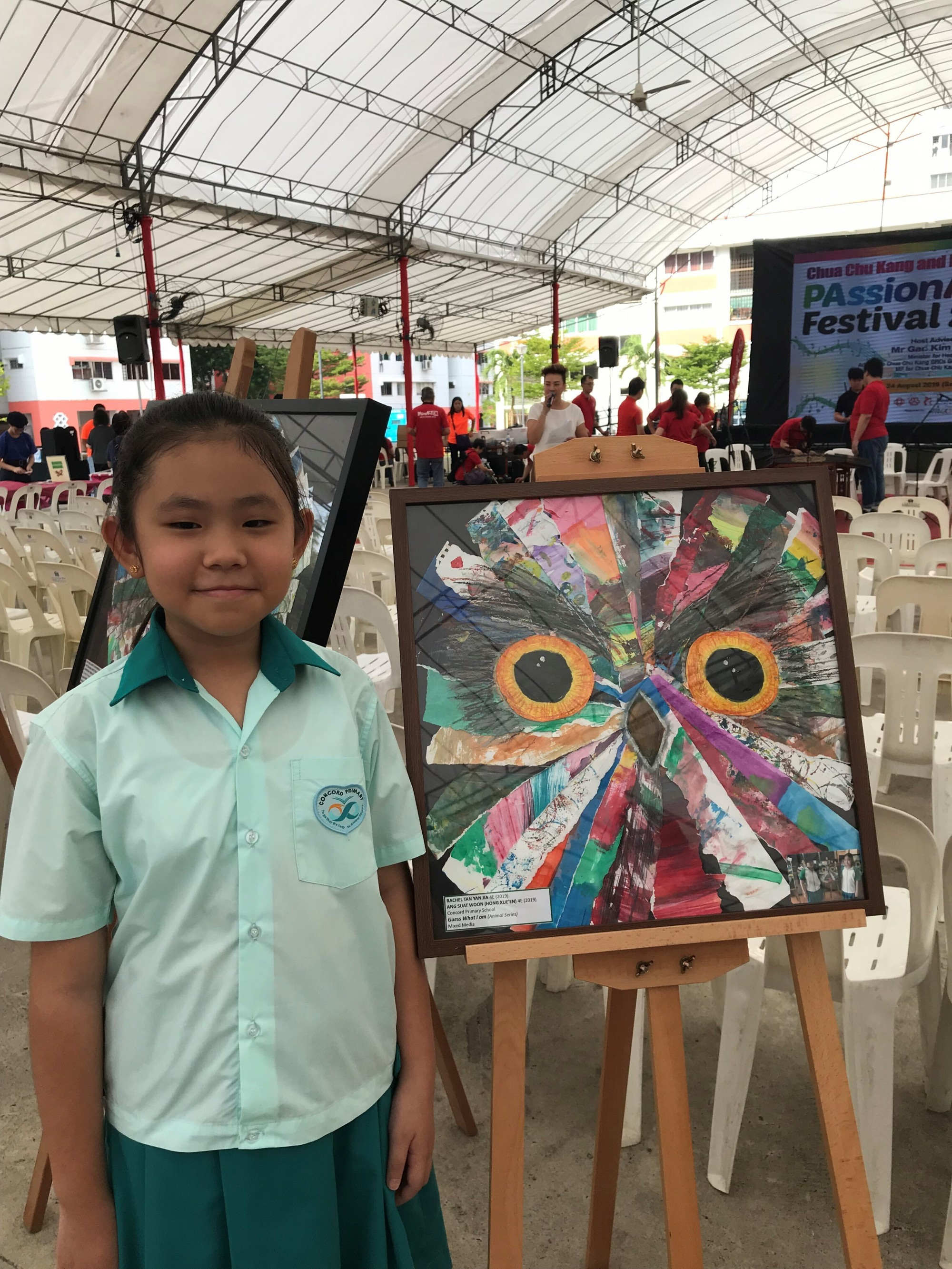 4. A Concordian with her artwork at the Passion Arts Festival.jpg