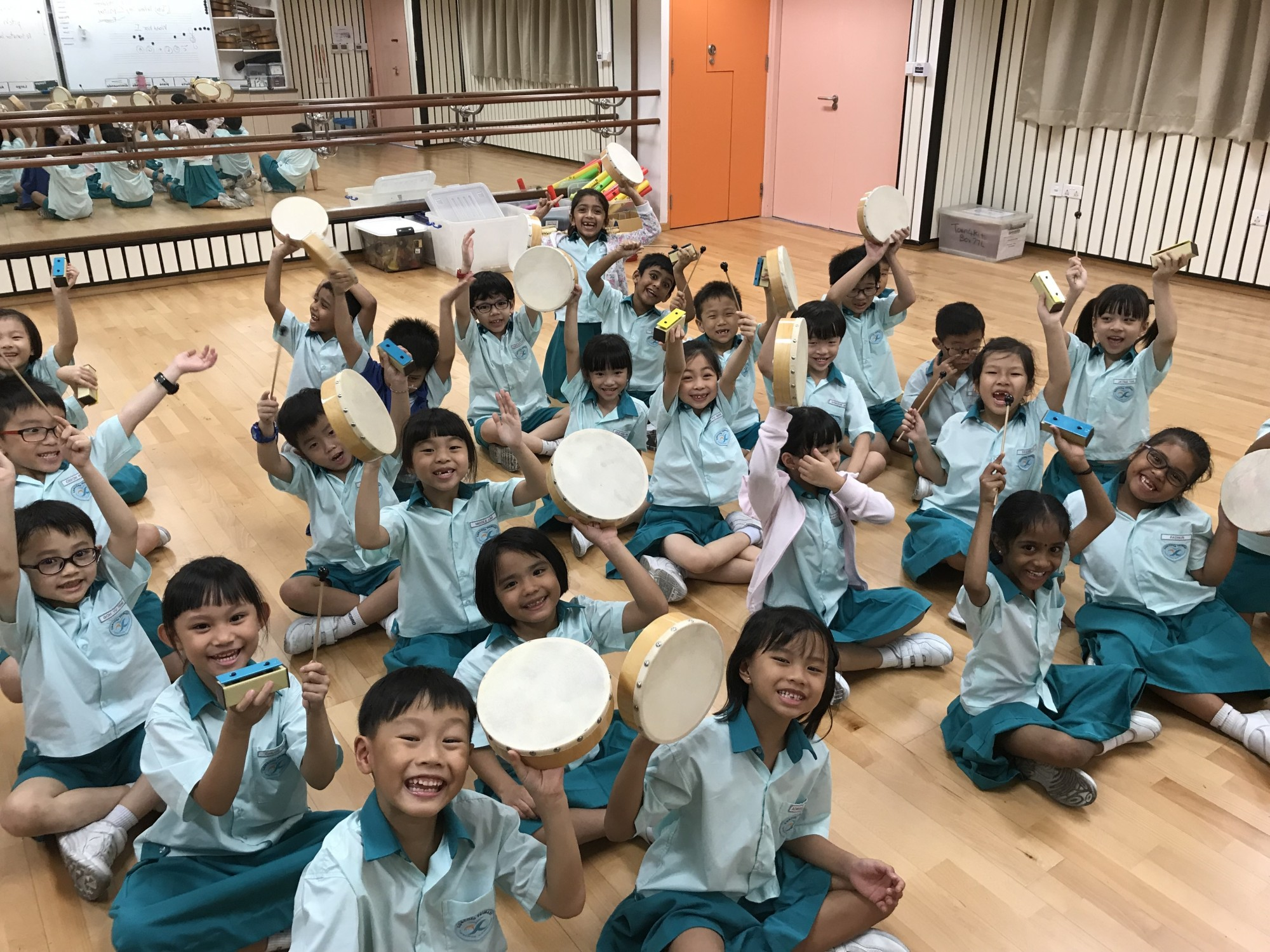 1. Performing with classroom percussion instruments.jpg