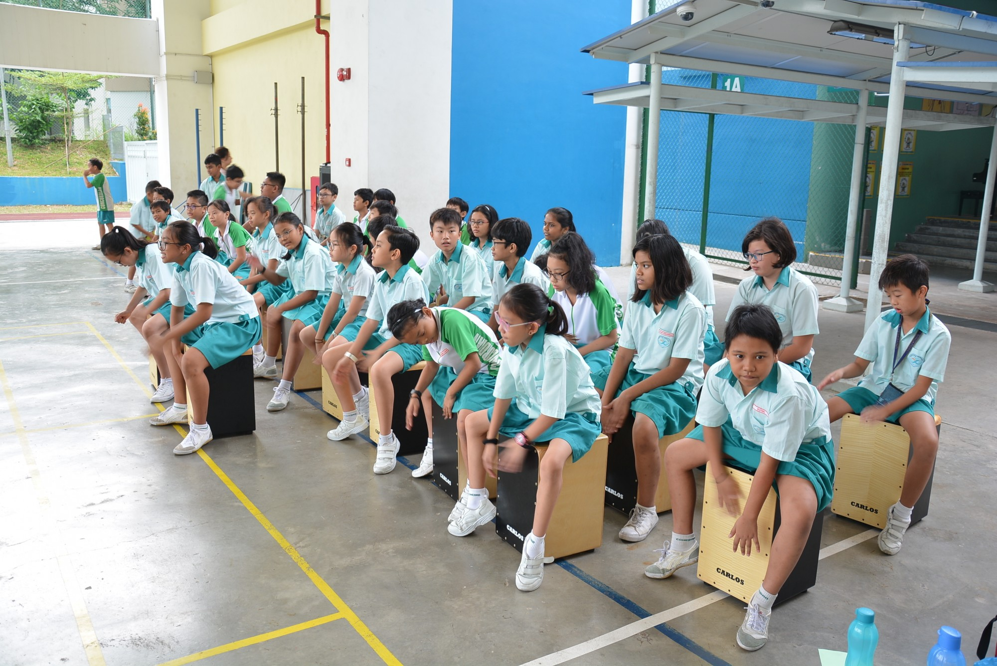 3. P5 students performing on the cajaon during recess.JPG